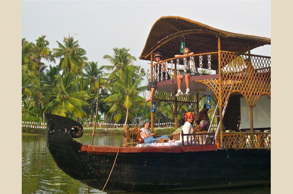 Relax on a comfortable houseboat while exploring the backwaters