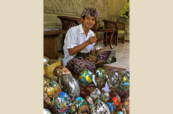 Art in Ubud takes myriad forms, including painting of miniatures on stone eggs (shown here), and stone and wood carving