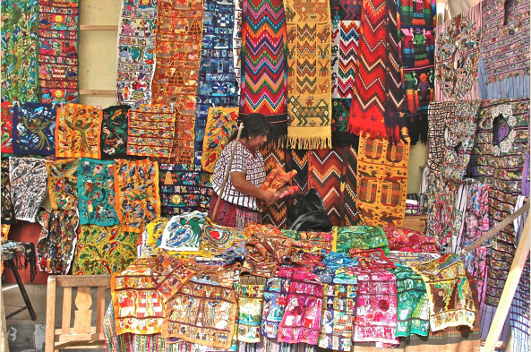 In Guatemalan markets find an profusion of brightly-colored, intricately-designed handwoven textiles.