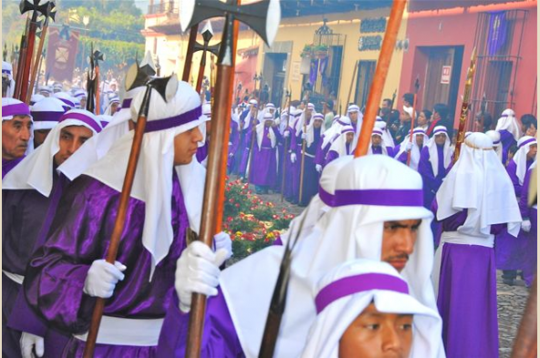 Celebrants wear purple for Good Friday processions