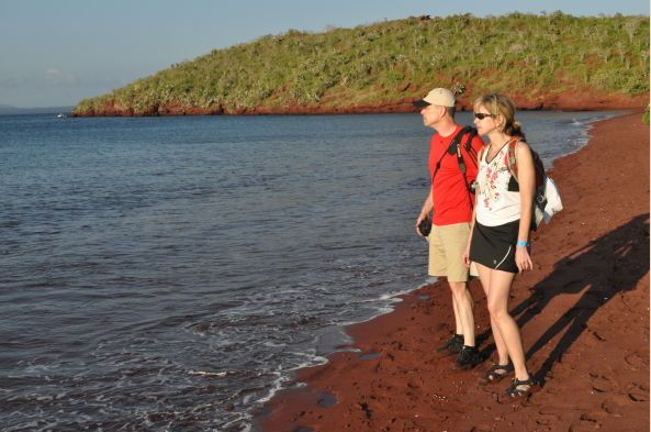 Admire and explore the red sand beach