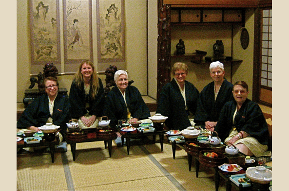 Enjoying a traditional dinner, dressed in yukatas, at the ryokan