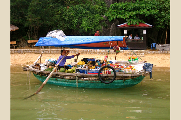 Local boat selling items at a floating market in the Mekong Delta
