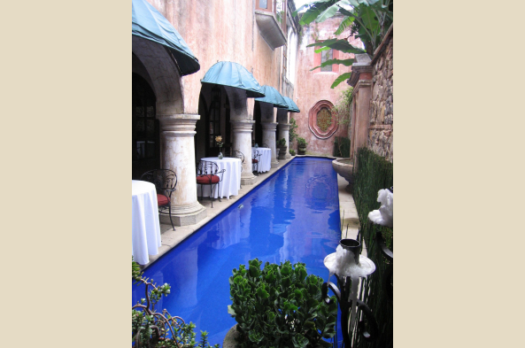 A pool in one of the many courtyards of Panza Verde.