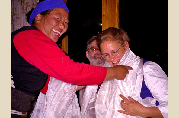 Traditional Sherpa welcome with a silk kata scarf