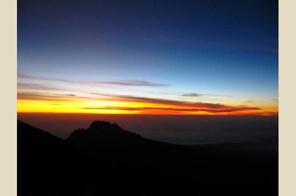 Behold sunrise from high on Kilimanjaro