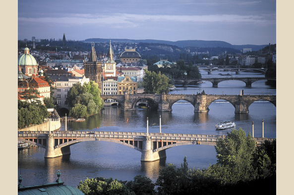 Prague is a green city located on the shore of the Vltava River.