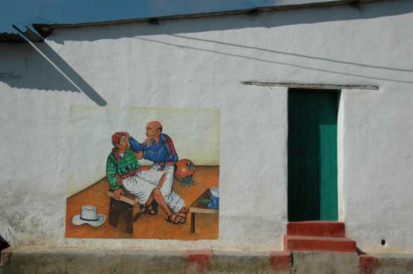 The exterior of house and shops in San Juan Atitlan are typically decorated with mural paintings.
