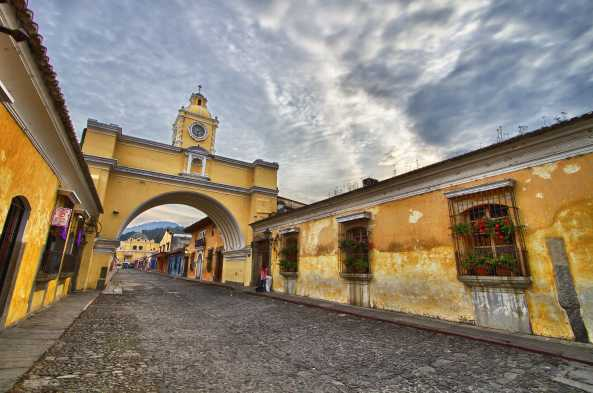 Antigua's emblematic yellow arch and cobblestone streets
