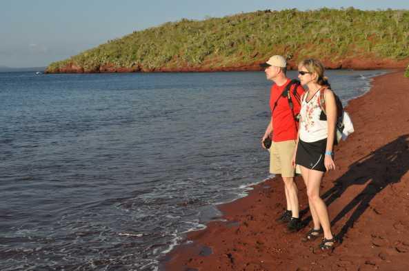 Admire and explore Rabida's red sand beach